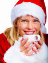 Christmas woman drinking a cup of hot chocolate Royalty Free Stock Images