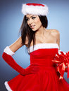Christmas woman with gift, Stock Image