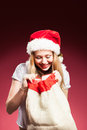 Christmas woman with gifts box at red background Stock Images