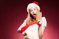 Christmas woman with gifts box at red background Royalty Free Stock Image