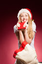 Christmas woman with gifts box at red background Stock Photography
