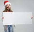 Christmas woman hold big white card. Santa hat. Royalty Free Stock Photo