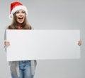 Christmas woman hold big white card. Santa hat. Royalty Free Stock Photo