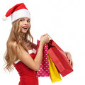 Christmas woman holding a shopping bags Stock Images
