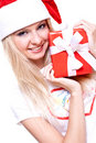 Christmas woman with holiday gift Stock Image