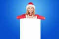 Christmas woman in santa hat holding card Royalty Free Stock Photo