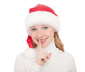 Christmas woman secret in a hat isolated on white Royalty Free Stock Photo