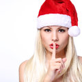 Christmas Woman. Sexy Blonde Girl in Santa Hat showing Hush Royalty Free Stock Photo
