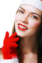 Christmas woman smiling portrait close up young wearing santa hat and red gloves closeup photo of cute asian caucasian Stock Photography