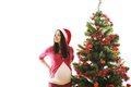 Christmas woman young pregnant is decorating tree Royalty Free Stock Photos