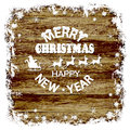 Christmas wood background, snow frame, Santa Claus, reindeer on a wooden background Royalty Free Stock Photo