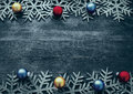 Christmas wooden background with decorative snowflakes and Christmas balls. Royalty Free Stock Photo