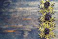 Christmas wooden background with decorative snowflakes and pine cones. Royalty Free Stock Photo