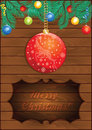 Christmas wooden background with red ball magic and fir branches Royalty Free Stock Photo