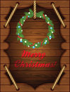 Christmas wooden background with wreath fir and rope Royalty Free Stock Photo