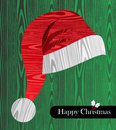 Christmas wooden textured Santa hat shape card Stock Photo