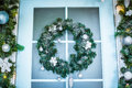 Christmas wreath with baubles, cones and evergreen boughs Royalty Free Stock Photo