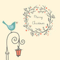 Christmas wreath with bird on the old street light. Vintage New Year and Christmas element. Christmas greeting card. Royalty Free Stock Photo