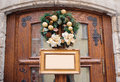 Christmas wreath decorated with gold balls on wooden door and frame with place for your text