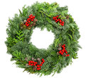 Christmas wreath fir, pine, spruce twigs with cones red berries Royalty Free Stock Photo