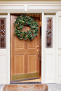 Christmas wreath on front door Stock Photo