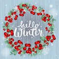 Christmas Wreath made of Red Berries with eucalyptus leaves and text Hello Winter, vector Royalty Free Stock Photo