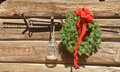 Christmas Wreath on Old Barn with Saw Royalty Free Stock Photo