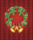 Christmas Wreath with Ornaments Bells Candy Cane Royalty Free Stock Photos