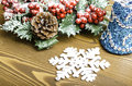 Christmas wreath with pine cones, bell and snowflake. Royalty Free Stock Photo