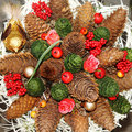 Christmas wreath with pine cones and flowers decorated Stock Photography