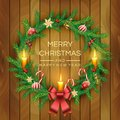 Christmas Wreath with red berries, candles, candy canes, bow, golden bell and balls on wooden board background. Vector