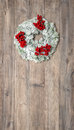 Christmas wreath with red berries. Festive decoration Royalty Free Stock Photo