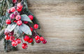 Christmas wreath from red berries, a fur-tree and cones. Royalty Free Stock Photo