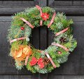 Christmas wreath with red ribbon and nut hanging on the door Stock Photography