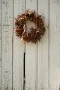 Christmas wreath on side of barn