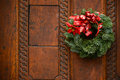 Christmas wreath on wooden door decoration this image represents the Stock Photo