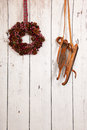 Christmas wreath on wooden wall hanging with copy space Stock Photo