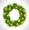 Christmas wreath with yellow glassy led christmas lights garland like frame in snowfall on grayscale background Stock Image