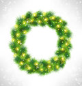 Christmas wreath with yellow glassy led christmas lights garland like frame in snowfall on grayscale background Royalty Free Stock Images