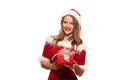 Christmas, x-mas, winter, happiness concept - smiling woman in santa helper hat with gift box, isolated on White Royalty Free Stock Photo
