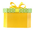 Christmas yellow gift box with a bow isolated on white with clipping path Royalty Free Stock Photo