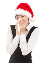 Christmas young woman sneezing into tissue Royalty Free Stock Photography