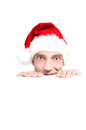 Chritmas red hat young man looking in a festive for the new year Royalty Free Stock Images