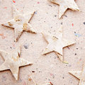 Chritmas stars on recycled paper background Stock Image