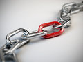 Chrome chain with a red link Royalty Free Stock Photography