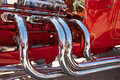Chrome exhaust system on hot rod Royalty Free Stock Photo