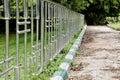 Chrome fence unswept path Gardens Bangalore Royalty Free Stock Photo