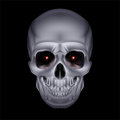 Chrome mystic skull with red sparks in the eyes on black background Stock Photo