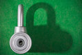 Chrome padlock metal on green background Stock Photo