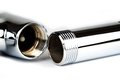 Chrome pipe tube with a screw top and bottom Stock Image